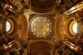 Indoor the St. Stephen`s Basilica in Budapest. The interior is decorated with golden elements.