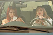 Friends driving together, feeling tired