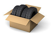 Delivery of tires. Set of four tires in a cardboard box for order delivery. isolated on white background. 3d render