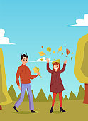 Vector illustration of a couple of a guy and a girl walking in an autumn park.