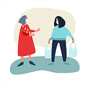 Volunteer helps elderly woman with shopping. Social work during coronavirus quarantine concept