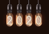 Number 2020 on electric light bulbs hanging from ceiling