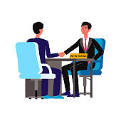 Two businessmen at HR interview - cartoon men shake hands sitting at desk