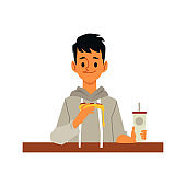 Man eating junk food pizza slice and holding soda cup