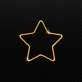Golden star shape made of sparkly magic light isolated on black background