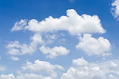 blue sky and white fluffy cloud horizon outdoor for background.