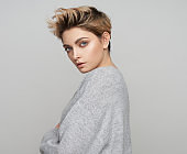 Portrait of sexy blonde female model with short hair