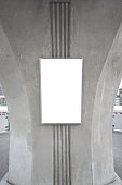 large blank advertise billboard white LED screen vertical on big concrete pole walk way outdoor in city.