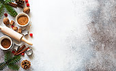 New Year an Christmas stone background with baking ingredients, fir twigs and cones