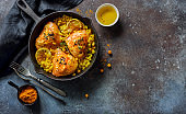 Fried chicken thighs with rice and chickpeas