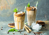 Iced latte coffee in a tall glass