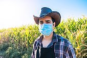 Farmer worker wearing a protective face mask due Covid-19 contagion prevention