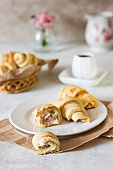 Red berry filling short crust pastry crescent rolls cookies. Jam rugelach (croissant), freshly baked sweet buns or bread rolls. Copy space.