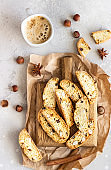 Italian homemade biscotti cookies or cantuccini with hazelnuts and a cup of coffee.