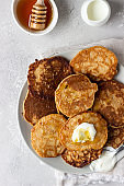 Buckwheat pancakes with honey and sour cream. Breakfast or brunch. Gluten free pancakes.