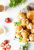 Profiteroles (cream cabbage) - French cabbage pastry balls with cottage cheese and cream with strawberry, mint and cup of coffee.