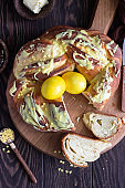Swirl brioche with citrus glaze decorated with painted yellow eggs. Braided or roll bread, Babka.