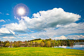 panoramic landscape in Bavaria with mountains and meadow at springtime