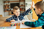 child boy homework school education classroom studying childhood home kid student high five
