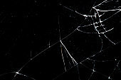 cracked glass isolated on a black background.