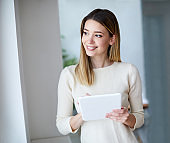young girl woman tablet smiling casual portrait computer beautiful happy business businesswoman office