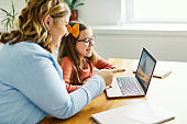 laptop computer education mother children daughter girl familiy childhood home child parent