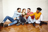 young people having fun happy group friendship beer cheers alcohol drink