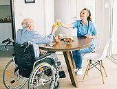 nurse doctor senior care caregiver help assistence wheelchair retirement home nursing elderly man