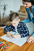 homework teaching education mother children son familiy childhood child teacher classroom