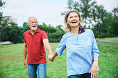 senior couple happy elderly love together retirement lifestyle smiling man woman mature fun