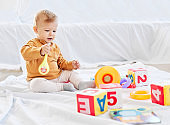 child baby boy playing childhood toy toddler cute fun little