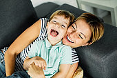 child son mother family happy playing kid childhood mom love fun smiling little woman home