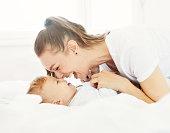 mother child baby having fun family happy childhood care cheerful cute boy sun