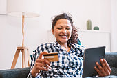 Serene black woman shopping online and electronic banking