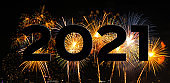 New year celebration fireworks on text 2021 for new year's event for new year's event