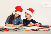Elementary age child, creating art, school in art class, classroom, christmas products