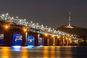 Seoul City skyline at Dongjak Bridge and Han river with beautiful light in Seoul, South Korea.
