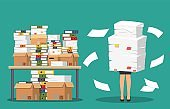 Businesswoman holds pile of office papers and documents.