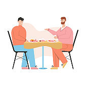 Gay couple have romantic dinner at restaurant