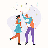 Man and woman celebrating at party, dancing and laughing