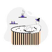Woman enjoys aromatherapy in wooden bathtub at spa salon