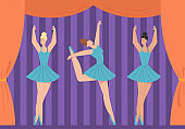 Graceful ballerinas in tutus dancing on stage of theater