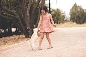 Kid girl walking in park