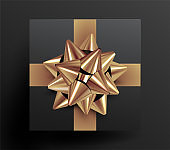 Realistic top view black gift box package with golden ribbons and golden bow knot on black background for banner or poster or flyer design. Vector illustration.