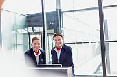 Portrait of smiling young attractive passenger service agent standing in airport