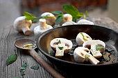 fresh Mushrooms fried in a frying pan