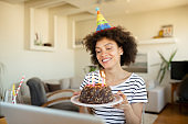 Happy African American woman having a birthday party at home