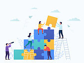 Coworkers connect puzzle pieces, teamwork. Business concept partnership, cooperation of businessmen and businesswomen, career growth, development and success.