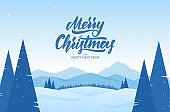 Mountains winter snowy landscape with hand lettering of Merry Christmas