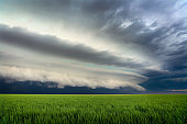 Dark storm clouds in the sky over a field